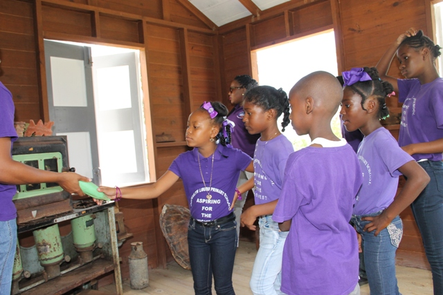 Students from the Joycelyn Liburd Primary School visiting a traditional Nevisian home at the Ministry of Tourism's Nevisian Heritage Life at the Nevisian Heritage Village in Zion on May 05, 2016
