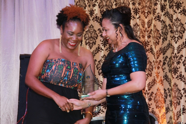Trisha Griffin of the Nevis Historical and Conservation Society receives the 2016 Most Popular Attraction Award for the Alexander Hamilton Museum from Mrs. Sharon Brantley, wife of the Minister of Tourism Hon. Mark Brantley, on behalf of the Ministry of Tourism at the Tourism Awards Gala and Dance at the Four Seasons Resort on May 28, 2016