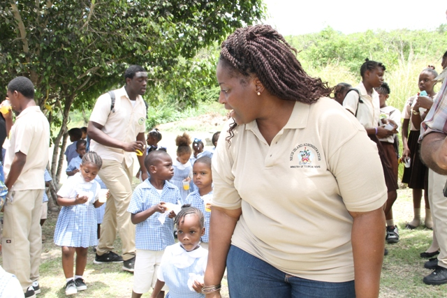 Nicole Liburd, Coordinator of the Ministry of Tourism's Nevisian Heritage Life with pre schoolers at the Nevisian Heritage Village in Zion on May 05, 2016