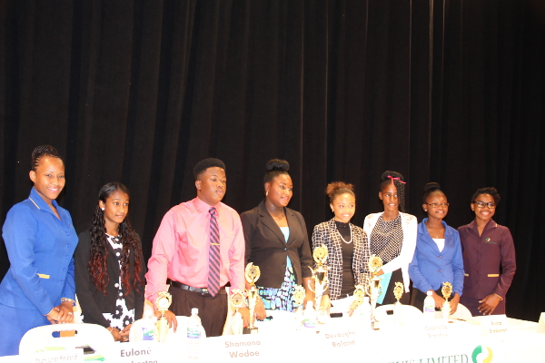(Fourth from left) Euloné Pemberton of the Gingerland Secondary School, Nevis' 2016-2017 Junior Tourism Minister and winner of the 2016 Bank of Nevis Ltd. Tourism Youth Congress with (immediate right) Gabriella Brantley second place winner and (immediate left) third place winner Devaughn Roland with other participants and Bank of Nevis Representatives (extreme left) Bronte Swanston-Hendrickson and (extreme right) Ms. Zadia Browne