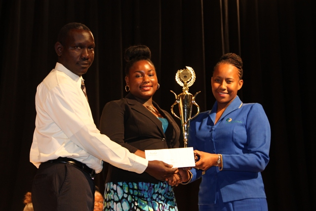 (l-r) Euloné Pemberton of the Gingerland Secondary School, Nevis' 2016-2017 Junior Tourism Minister flanked by (left) Assistant Secretary in the Ministry of Tourism John Hanley and Bank of Nevis Representative Bronte Swanston-Hendrickson at the end of the 2016 Bank of Nevis Ltd. Tourism Youth Congress on May 19, 2016 at the Nevis Performing Arts Centre