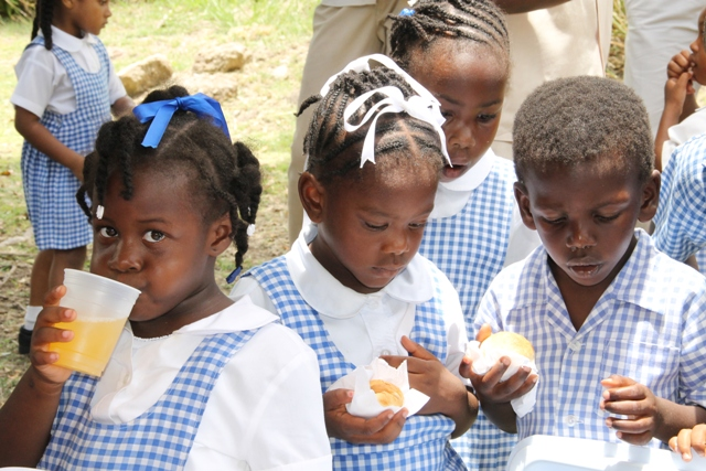 Students of the Charlestown Pre School sampling hot bread and butter baked in a traditional stone oven at the Nevisian Heritage Village at Zion Village on May 05, 2016, at the Ministry of Tourism's Nevisian Heritage Life event