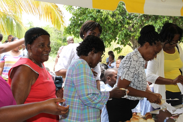 Seniors awaiting hot bread and butter at the Ministry of Tourism's Nevisian Heritage Life at the Nevisian Heritage Village in Zion on May 05, 2016