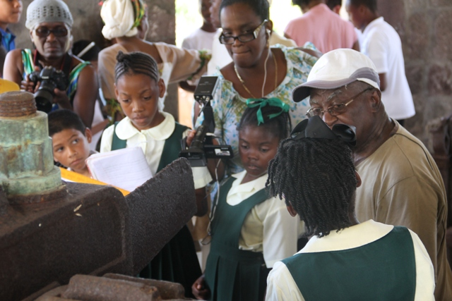 Theodore Kelly, one of the last persons to witness the operations of the New River Estate sugar mill, recounts events at the mill house for students and other spectators during a tour on May 18, 2016, on International Museum Day hosted by the Nevis Historical and Conservation Society and the Ministries of Tourism and Agriculture