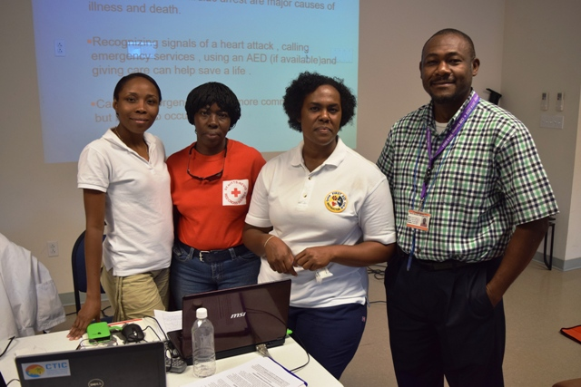 (L-r) Nurse Gracelyn Hanley, co-instructor and volunteer at the Red Cross Nevis Branch; instructor Gweneth Browne; instructor and health educator Nurse Roxanne Brookes and Director of the Nevis Disaster Management Department Brian Dyer at the department's offices at Long Point on June 15, 2016