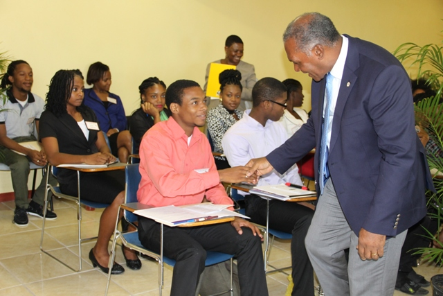Premier of Nevis and Minister of Education Hon. Vance Amory and Principal Education Officer Palsy Wilkin interact with participants at the Department of Education's 2016 Prospective Teachers' Course on June 20, 2016 at the Department's conference room at Pinney's Industrial Site