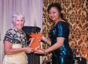 Pamella Barry, patron of the Ministry of Tourism's Awards Gala and Dance, is presented with a hand carving by local craftsman Kennedy Tyrell presented by Mrs. Sharon Brantley, wife of the Minister of Tourism Hon. Mark Brantley, on behalf of the Ministry of Tourism at the Tourism Awards Gala and Dance at the Four Seasons Resort on May 28, 2016