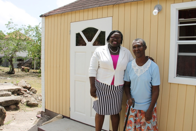 Junior Minister in the Ministry of Social Development Hon. Hazel Brandy-Williams with Ingrid Browne of Hickman's Village on June 15, 2016, share a light moment after handing over keys to Browne for an extension of her home through the ministry's Community Housing Project