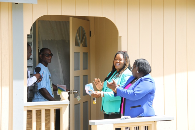Egbert Clarke (second from right) with Permanent Secretary in the Ministry of Community Development Keith Glasgow (left) Junior Minister Hon. Hazel Brandy-Williams (extreme right) and Assistant Secretary Michelle Liburd (second from right) moments after receiving keys to an extension of the family home at Butlers Village on June 15, 2016