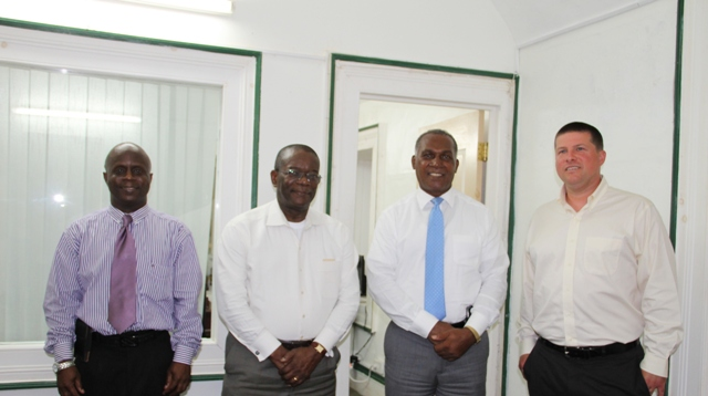 L-R) Permanent Secretary in the Premiers Ministry Mr. Wakely Daniel, St. Kitts and Nevis Ambassador to the Organisation of American States (OAS) His Excellency Dr. Everson Hull, Premier of Nevis and Minister of Education Hon. Vance Amory and Mr. Christian Goodwillie, Director and Curator of Special Collections and Archives at the Burke Library, Hamilton College in Clinton, New York, United States of America at Bath Hotel on June 20, 2016