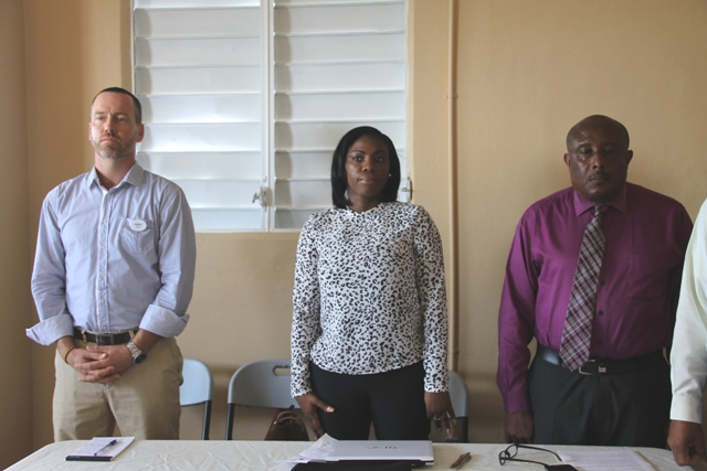 Facilitator of the Gingerland Community-Based Tourism Workshop Mr. James Crockett, Tourism Specialist at the Organisation of the Eastern Caribbean States Commission Tourism Desk, Dr. Lorraine Nicholas, and Permanent Secretary in the Ministry of Tourism Carl Williams at the workshop's opening ceremony on June 27, 2016, at the Hardtimes Conference Centre in Gingerland