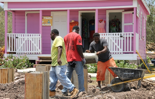 Workmen working on additional units at the Nevisian Artisan Village next to the Nevis Craft House at Pinney's on June 16, 2016