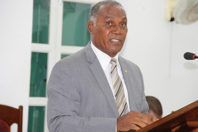 Hon. Vance Amory, Premier of Nevis and Minister of Finance presenting resolutions at a sitting of the Nevis Island Assembly on July 12, 2016