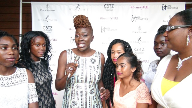 Nevis-born Emmy Award winning hair stylist Petula Skeete (middle) with five budding fashion designers from Nevis and Director of Youth Development Zahnela Claxton (extreme right) at the end of Skeete's #beautyFULL Women's Conference at the Four Seasons Resort on July 03, 2016