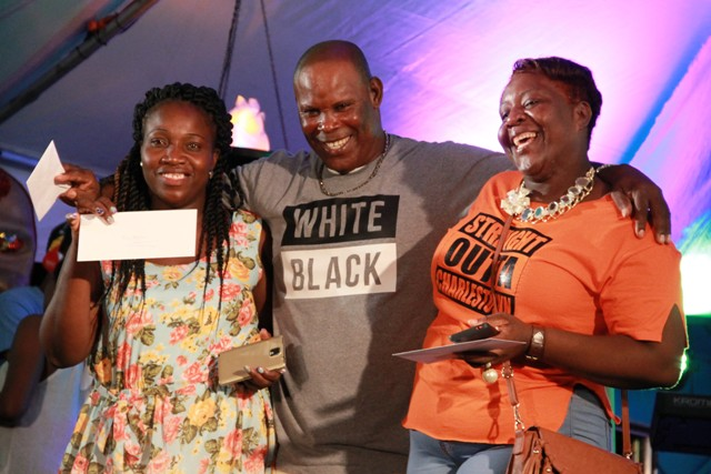 Die-hard patrons of Culturama (l-r) Julie Prentice, Sylvester Pemberton and Shelly Taylor moments after they were presented with tickets to attend shows during Culturama 42 during the launch of Culturama 42 at the Charlestown waterfront on July 21, 2016