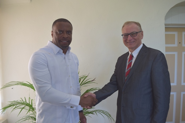 (l-r) Foreign Affairs Minister in St. Kitts and Nevis Hon. Mark Brantley welcomes Poland's Ambassador to St. Kitts and Nevis His Excellency Piotr Kaszuba at his office in the Nevis Island Administration's Bath Plain building on July 13, 2016