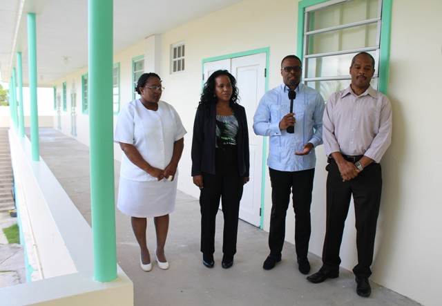 (l-r) Acting Matron at the Alexandra Hospital Jessica Scarborough, Permanent Secretary in the Ministry of Health Nicole Slack-Liburd, Minister of Health Hon. Mark Brantley and Hospital Administrator Gary Pemberton outside the newly refurbished maternity ward at the Alexandra Hospital on July 15, 2016