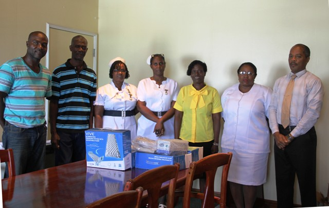 (L-r) Nigel Simmonds, Livingstone Simmonds, Assistant Nurse Manager Bernadette Jeffers, Nurse Manager Joya Parry-Lake, Lornette Webbe, Acting Matron Jessica Scarborough and Hospital Administrator Gary Pemberton with the gifts donated by the Simmonds Family to the hospital on July 14, 2016