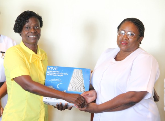 (L-r) Lornette Webbe, representative of the Simmonds family of Hanley's Road handing over a gift of six alternating pressure systems with adjustable pumps to Acting Matron at the Alexandra Hospital Jessica Scarborough at the hospital's conference room on July 14, 2016