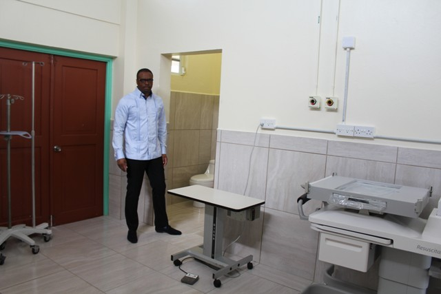 Minister of Health on Nevis Hon. Mark Brantley takes a first-hand look at new tile work at the Alexandra Hospital's maternity ward on July 15, 2016