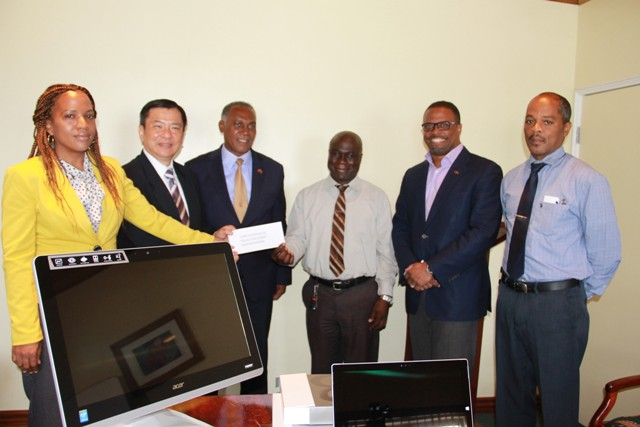 Republic of China (Taiwan)'s Resident Ambassador to St. Kitts and Nevis His Excellency George Gow Wei Chiou (second from left) presents almost $200,000 cheque to (l-r) Premier of Nevis and Minister responsible for Ports Hon. Vance Amory, General Manager of the Nevis Solid Waste Management Authority Andrew Hendrickson, Deputy Premier of Nevis and Minister of Health Hon. Mark Brantley and Hospital Administrator Gary Pemberton with Permanent Secretary in the Ministry of Health Nicole Slack-Liburd at the extreme left at a handing over ceremony at the Alexandra Hospital conference room on July 25, 2016
