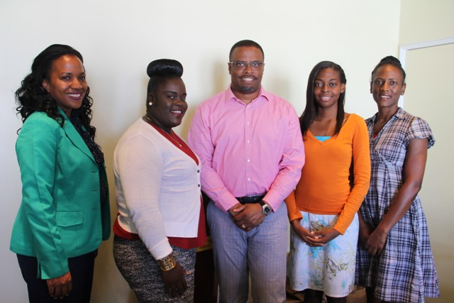Deputy Premier of Nevis and Minister of Health Hon. Mark Brantley (middle) flanked by the 2016/17 MUA/NIA scholarship awardees and Ministry of Health officials (l-r) Permanent Secretary Nicole Slack-Liburd, Laurencia Walters, Nicoyann Blackett and Health Planner Shelisa Martin-Clarke at the Alexandra Hospital conference room on July 19, 2016