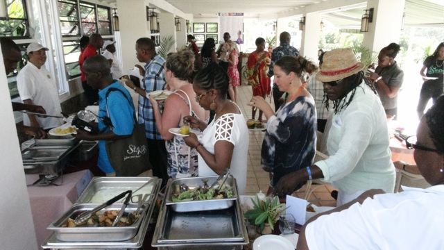 Guests enjoying samples offered by restaurants participating in the St. Kitts and Nevis Restaurant Week Tasting Showcase at the Mount Nevis Hotel on July 15, 2016