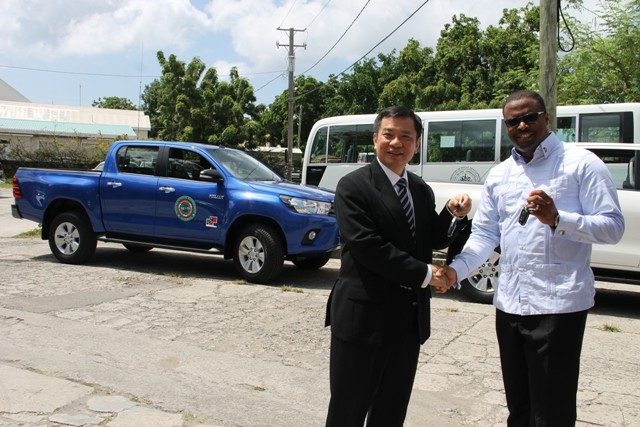 (L-r) Republic of China (Taiwan) Resident Ambassador to St. Kitts and Nevis His Excellency George Gow Wei Chiou, officially hands over the keys to two brand new Toyota trucks to Deputy Premier and Minister of Health Hon. Mark Brantley, at Government Headquarters in Charlestown on August 30, 2016, for use at the Nevis Solid Waste Management Authority and the Port Health Unit