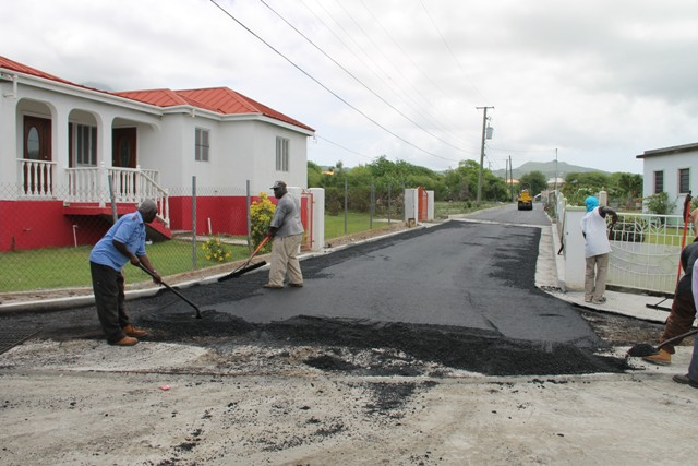 Members of the Public Works Department putting finishing works on the new Lower Farms/Bath Plain road on July 29, 2016