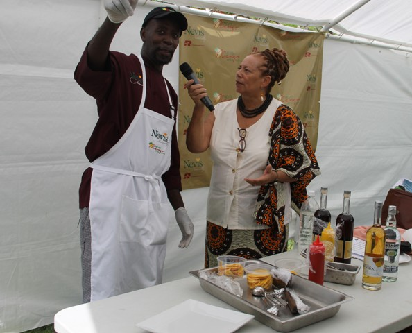 Local chef Llewellyn Clarke preparing to demonstrate his creation, Nevisian Mango Ice-cream with a Mango Coulis, drizzled with Brinley Gold Mango Rum infused with vanilla at the Nevisian Chefs Mango Feast at Oualie Beach during the third annual Nevis Mango and Food Festival