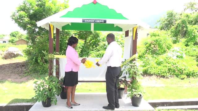 (l-r) Neva Manners-Limonta, Deputy Comptroller at the Inland Revenue Department and Collin Dore, Permanent Secretary in the Ministry of Finance commissioning the state-of-the-art bus stand on the Island Main Road near Horsford's Valu Mart adopted by the department on Nevis on August 12, 2016
