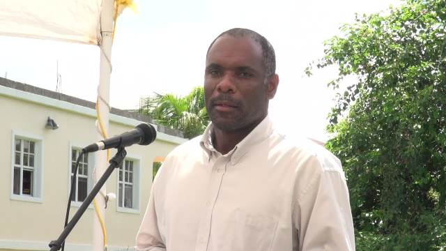 Permanent Secretary in the Ministry of Finance on Nevis Colin Dore delivering remarks at the unveiling of the Inland Revenue Department's state-of-the-art bus stand on the Island Main Road near Horsford's Valu Mart unveiled by the Inland Revenue Department  on Nevis on August 12, 2016