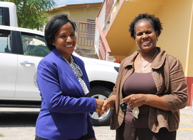 Permanent Secretary in the Ministry of Health on Nevis Nicole Slack-Liburd, hands over keys of a new Toyota truck to Medical Officer of Health Dr. Judy Nisbett, at a handing over ceremony at Government Headquarters in Charlestown, on August 30, 2016