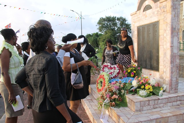 Some family and well-wishers of the 233 victims who perished during the MV Christena tragedy looking at the monument mounted on Samuel Hunkins Drive in their loved ones' honour adorned with flowers at the 46th annual Memorial Service at the Hamilton Museum Grounds on August 01, 2016