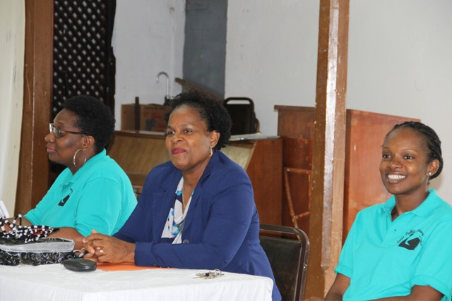 (l-r) Chairperson Shoya Lawrence, Dr. Judy Nisbett Medical Officer of Health in the Nevis Island Administration and Chief Librarian Anastasia Parris at the opening ceremony of the Nevis Public Library summer programme at the Charlestown Methodist Church Hall on August 03, 2016