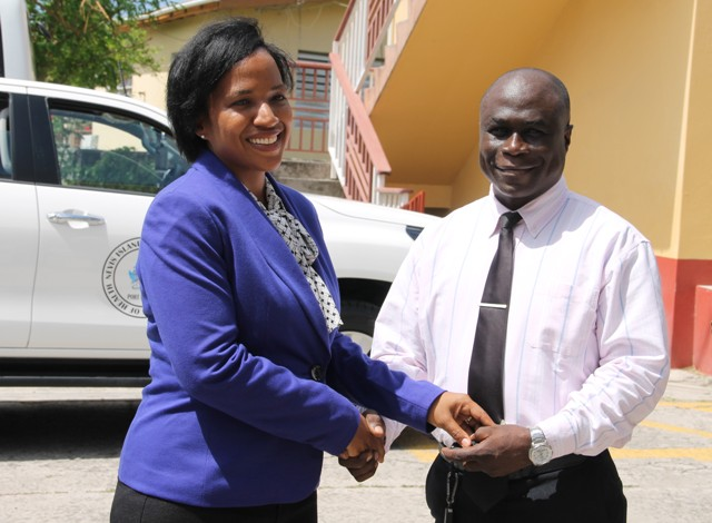 Permanent Secretary in the Ministry of Health on Nevis Nicole Slack-Liburd, hands over keys of a new Toyota truck to Manager of the Nevis Solid Waste Management Authority Andrew Hendrickson, at a handing over ceremony at Government Headquarters in Charlestown, on August 30, 2016