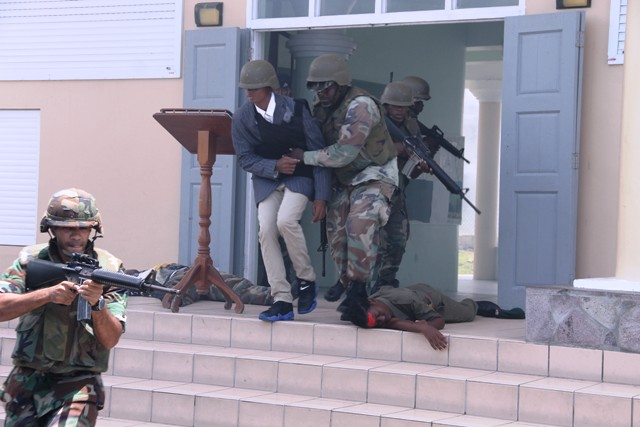 Officers of the Reserve Corps of the St. Kitts-Nevis Defence Force demonstrate their skills during a hostage situation at a training camp at the Elizabeth Pemberton Primary School at Cole Hill on August 25, 2016