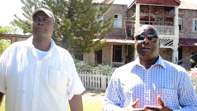 (l-r) Contractor for the restoration project of the Governor's House at Bath Plain Alton Brown and Hon. Alexis Jeffers, Minister responsible for Housing and Lands in the Nevis Island Administration on the site of the project on August 23, 2016