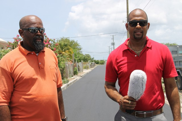 (L-r) Daniel Williams, Public Works Department Supervisor of the Road Division and Raoul Pemberton, Director of Public Works Department in the Nevis Island Administration at the Lower Farms/Bath Plain road on July 29, 2016