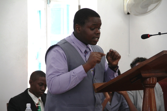 St. Kitts and Nevis top 2016 Caribbean Secondary Education Certificate examinations student Rol-J Williams, making a presentation at a sitting of the Youth Parliament at the Nevis Island Assembly in 2014