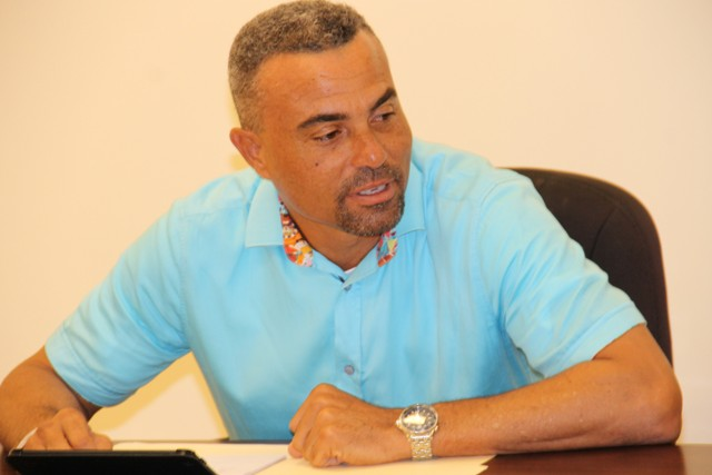 Ernie France, Chairman of the Nevis Division of the St. Kitts and Nevis Chamber of Industry and Commerce delivering remarks at a meeting for executive members with Premier of Nevis Hon. Vance Amory at the Premier's Ministry at Pinney's on September 13, 2016