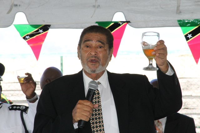 Deputy Governor General His Honour Mr. Eustace John raises a toast on the occasion of the 33rd Anniversary of Independence in St. Kitts and Nevis at the annual Police Toast at the Cicely Grell Hull - Dora Stephens Netball Complex on September 19, 2016, after the Independence Day Parade and Awards Ceremony at the Elquemedo T. Willett Park