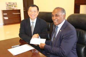 (L-r) Resident Ambassador of the Republic of China (Taiwan) to St. Kitts and Nevis His Excellency George Gow Wei Chiou presents a cheque on behalf of his government and people to Premier of Nevis Hon. Vance Amory for the procurement of equipment and a vehicle for the Information Technology Department in the Nevis Island Administration at the premier's office at Pinney's Estate on September 30, 2016