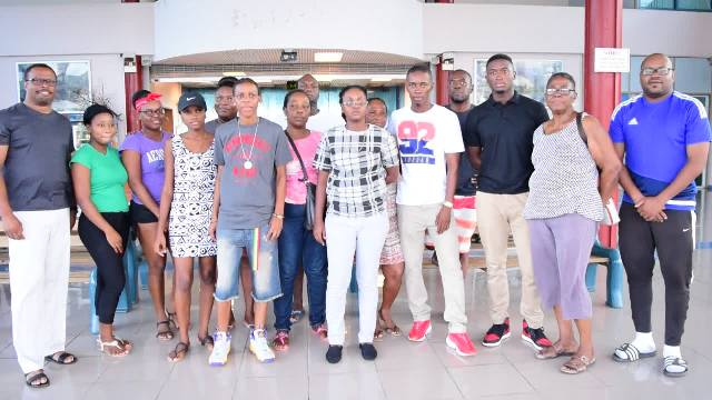 (Extreme left) Deputy Premier of Nevis and Minister of Sports Hon. Mark Brantley and Director of Sports Jamir Claxton (extreme right) with team of four and their family and wellwishers moments before their departure from the Vance W. Amory International Airport on September 03, 2016, to pursue sports studies in Jamaica
