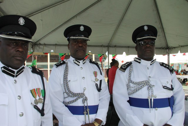 The High Command of the Royal St. Christopher and Nevis Police Force (l-r) Head of the Nevis Division Superintendent Trevor Mills, Andre Mitchel, Assistant Commissioner responsible for Crime and Deputy Commissioner Hilroy Brandy, at the annual Police Toast at the Cicely Grell Hull - Dora Stephens Netball Complex on September 19, 2016, after the Independence Day Parade and Awards Ceremony at the Elquemedo T. Willett Park