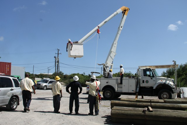 Linesmen from the Transmission and Distribution Department at the Nevis Electricity Company Limited, learning how to mount a rescue mission with the bucket truck from The Barbados Power & Light Company Limited's Technical Trainer Curtis Brewster at Prospect on September 14, 2016