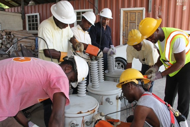 Linesmen from the Transmission and Distribution Department at the Nevis Electricity Company Limited, learning to wire transmitters at Prospect with (fourth from left) The Barbados Power & Light Company Limited's Technical Trainer Curtis Brewster at Prospect on September 14, 2016
