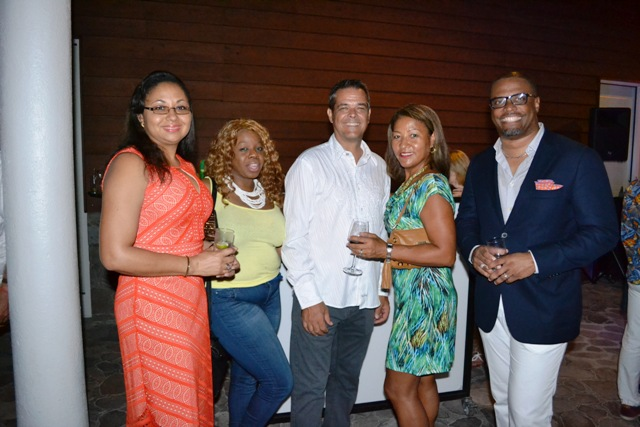 Deputy Premier of Nevis and Minister of Tourism Hon. Mark Brantley (extreme right) and Mrs. Brantley (extreme left) with Gary Colt, member of the Nevis Tourism Authority Board of Directors (third from left) and invitees at a cocktail reception held by the Premier's Ministry for participants at the annual Nevis Travel Symposium of Romance hosted by the Nevis Tourism Authority at the Four Seasons Resort on October 17, 2016