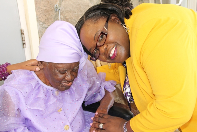 "Hon. Hazel Brandy-Williams, Junior Minister in the Ministry of Social Development on Nevis with Celian ""Martin"" Powell celebrating her 104th birthday on January 19, 2016, at the Flamboyant Nursing Home (file photo)"