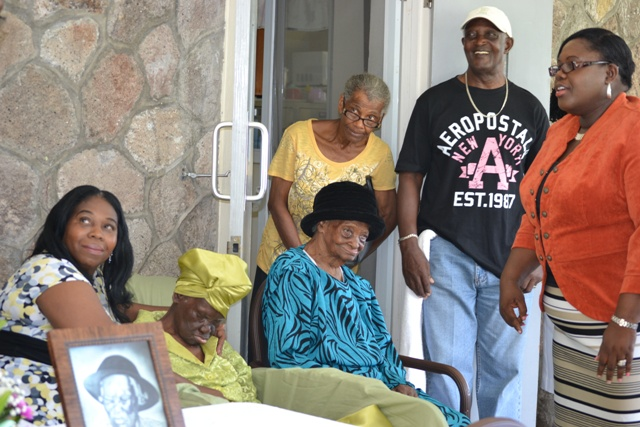 "(l-r)  Kathleen Rawlins, first granddaughter of Celian ""Martin"" Powell,  104-year-old Celian ""Martin "" Powell, Nevis' newest centenarian Rosetta Hull and her relatives and Hon. Hazel Brandy-Williams Junior Minister of Social Development at a ceremony to recognise the oldest person in St. Kitts and Nevis on October 13, 2016 at the Flamboyant Nursing Home"